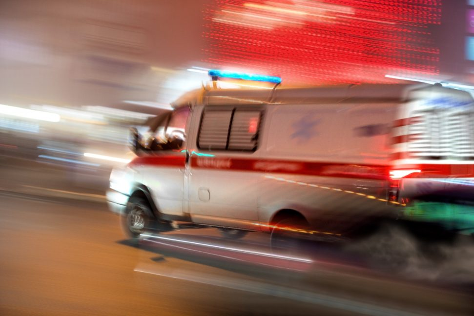 Photo of an ambulance rushing to the scene of an accident